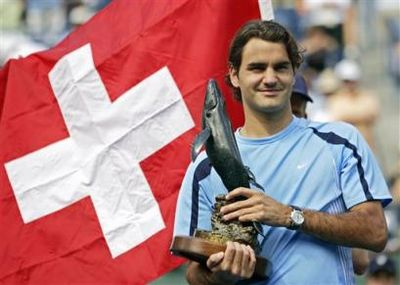 Roger Federer of Switzerland holds the championship trophy after defeating James Blake, 7-5, 6-3, 6-0, at the Pacific Life Tennis Open in Indian Wells, Calif. Sunday, March 19, 2006.