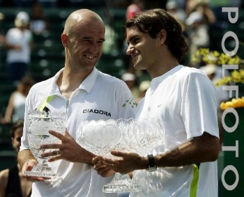 Ivan Ljubicic, left, of Croatia, and Roger Federer, of Switzerland, hold their trophies after the men's singles championship of the Nasdaq-100 Open tennis tournament Sunday, April 2, 2006