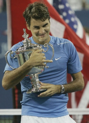Roger Federer of Switzerland poses with the championship trophy after defeating Andy Roddick in the men's final of the U.S. Open