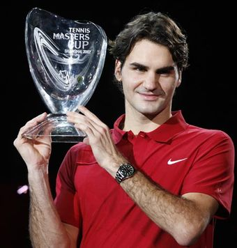 Roger holds his trophy