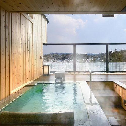 客室露天風呂の石造りタイプです。