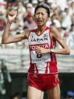 世界陸上の女子マラソンでゴールする銅メダルの土佐礼子 <br /> Photo By 共同  <br />