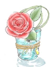 グラスに入った一輪のバラ