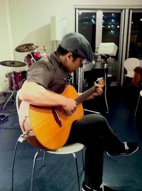 picci.guitar.playing.jpg