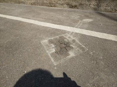 一時使用時の舗装補修前.JPG