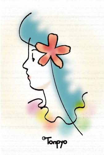 花の髪飾りをつけた女の子