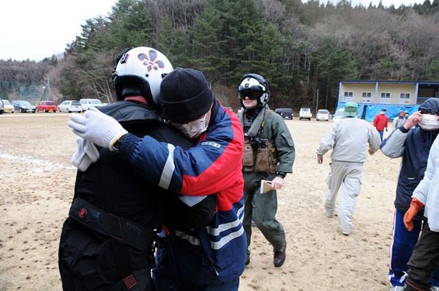 s-1024px-US_Navy_110315-N-IC111-461_Chief_Naval_Air_Crewman_Steven_Sinclair_is_embraced_by_a_Japanese_citizen_after_delivering_humanitarian_supplies.jpg