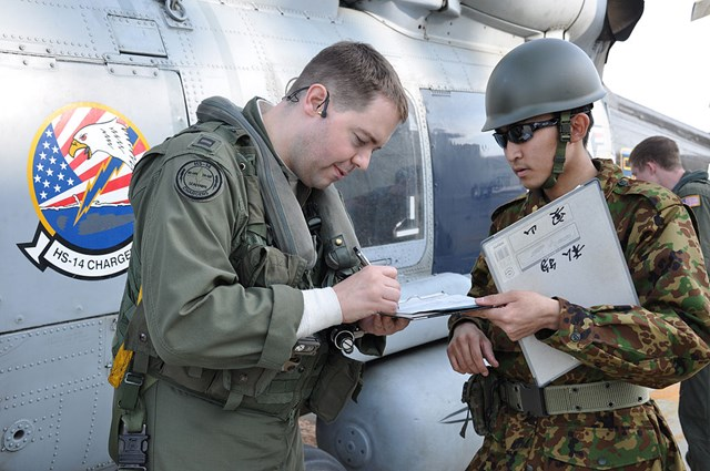s-1024px-US_Navy_110314-N-OB360-002_Lt__Jacob_King,_assigned_to_the_Chargers_of_Helicopter_Anti-Submarine_Squadron_(HS)_14,_signs_for_fuel_received_from_the.jpg