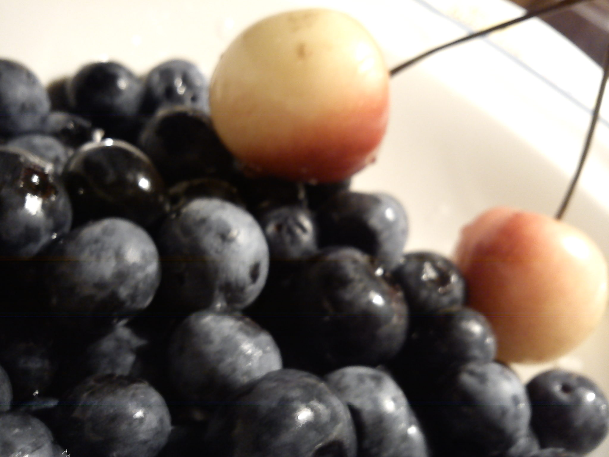 white cherries and blueberries