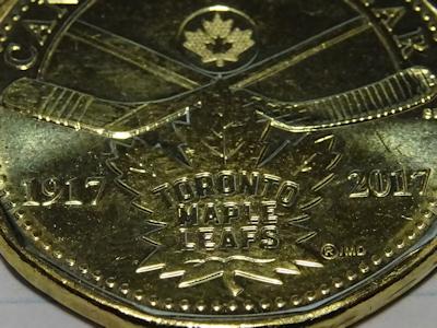 アイスホッケーが描かれているコイン