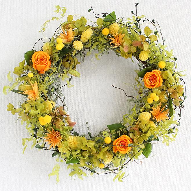 オレンジのミニバラと黄色い小花のプリザーブドフラワーリース