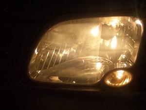 ヘッドライト右上■部に皮膜しました
