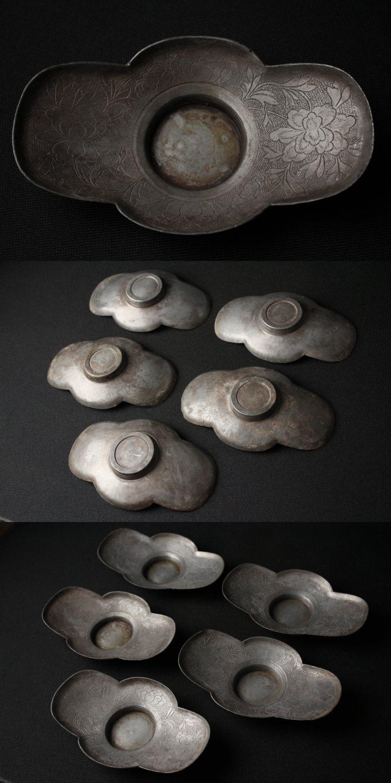 木瓜式の中に密度高く雕刻模様が敷き诘められたひ
